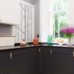 This kitchen features coordinating gold toned accessories, creating a glamorous look