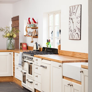 The accessories used here illustrate how well white works in a shabby chic kitchen