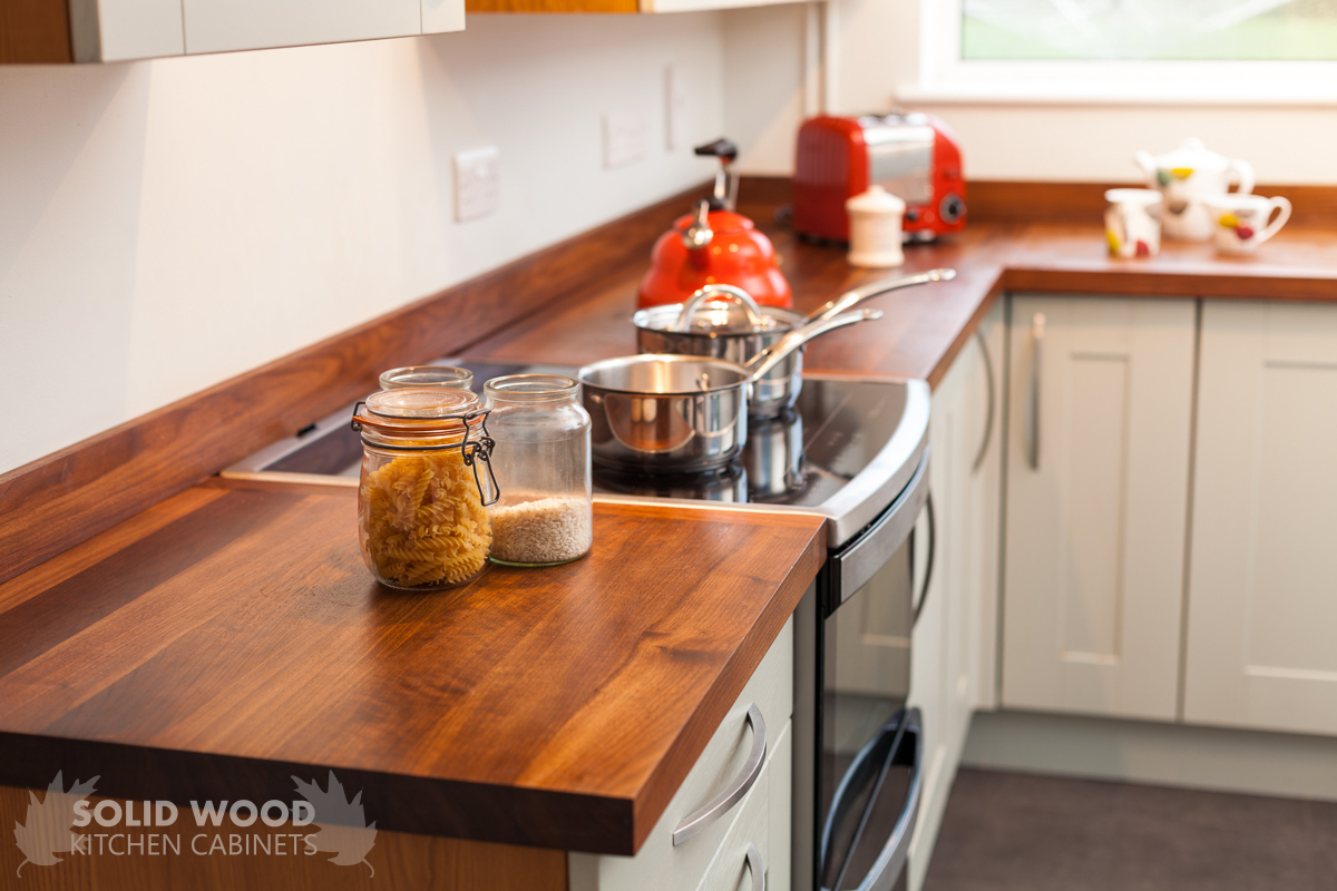 Amazing photo of American walnut worktops in a solid wood kitchen with #BA3411 color and 1200x800 pixels