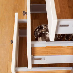 This set of Antaro drawers shows a larger drawer being used to store pots and pans.