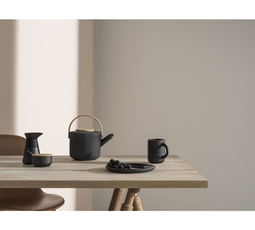 This black Stelton Theo stoneware teapot perfectly demonstrates Japandi design.
