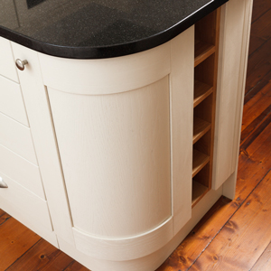 The contrast between black and white, as well as the curve of the cabinet, gives this island an Art Deco feel.