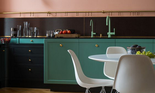 This pink, teal and black kitchen is full of contemporary style.