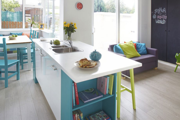 Bright colours are used to liven up a white small open plan kitchen