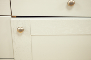 Kitchen cabinet hinges that need adjusting to realign the cupboard door.