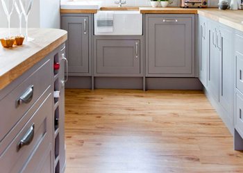 This laminate kitchen floor has the appearance of timber.