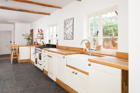 This one-wall traditional kitchen has been painted in Farrow & Ball's Wimborne White.