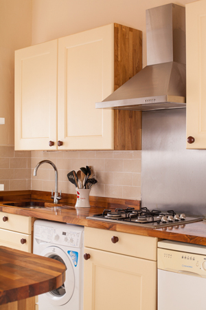 This kitchen has traditional solid oak cabinet frontals painted in Farrow & Ball's Cream.