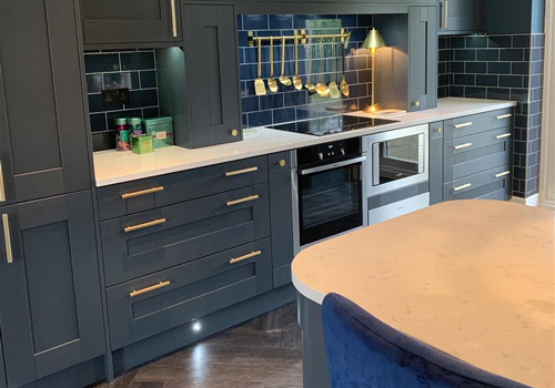 This cabinets in this kitchen have been painted in Farrow & Ball's Hague Blue.