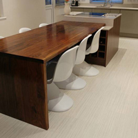 Dark wood and a simplistic design gives this integrated dining table a contemporary feel.