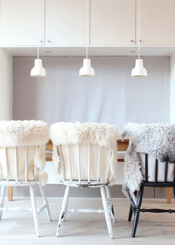 Hang faux fur over chairs and other seating to create a Scandinavian inspired kitchen.