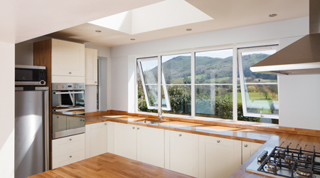 The location of this G-shaped kitchen benefits from the fantastic view.