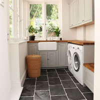 This L-shaped utility room has solid wood worktops.