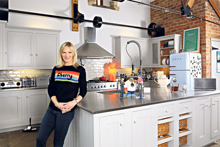 Radio 2 DJ Jo Whiley in her kitchen, which has stainless steel worktops and a neutral colour scheme