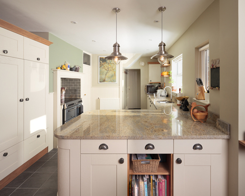 An L-shaped kitchen with plenty of storage space.