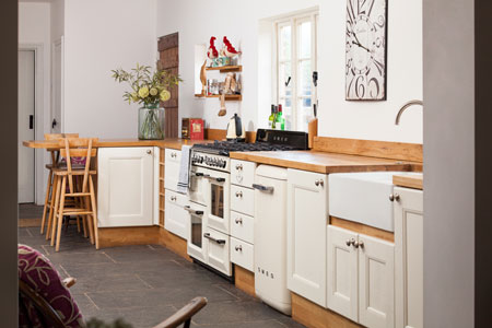 The cabinet frontals in this large family kitchen have been painted in Wimborne White.