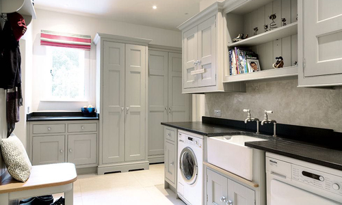 This utility room has black and greige colour scheme.