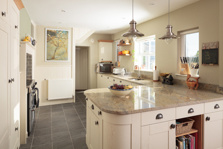 An assortment of tall, curved and base cabinets provide ample storage in this kitchen.