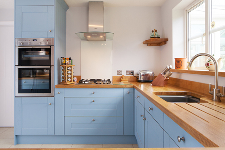 These solid oak kitchen cabinets have been painted Lulworth Blue by Farrow & Ball.