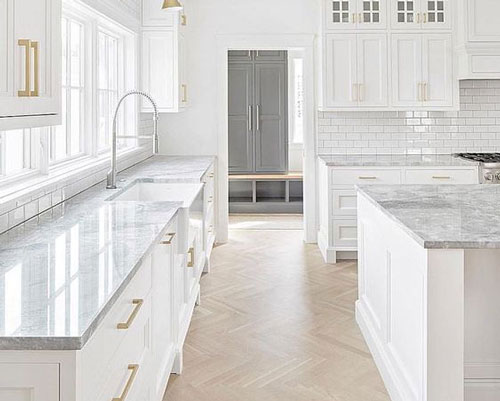 Marble worktops are perfectly suited to kitchens with a light colour palette.