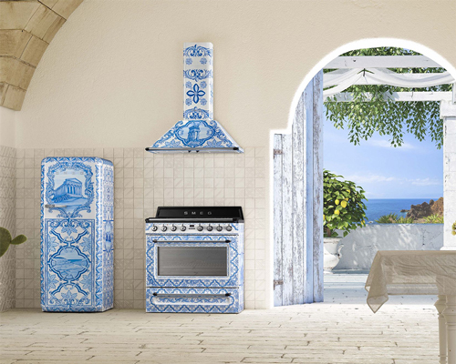 An open Mediterranean kitchen with an intricately designed Smeg fridge, oven and hood