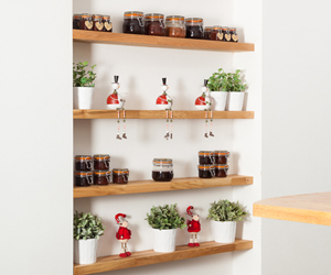 Neatly organise shelves to make them more appealing .