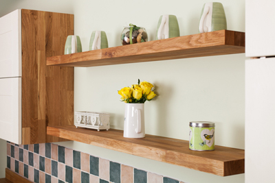 Open, floating shelves are a great way to store kitchen equipment.