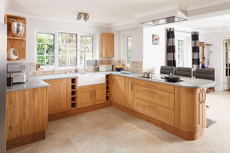 This kitchen has a peninsula with seats which is ideal for entertaining whilst cooking.