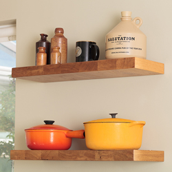 Open shelving with decorative kitchen items placed on the shelves