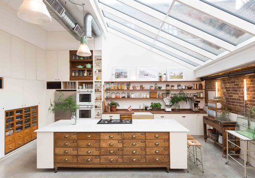 Jamie Oliver's celebrity kitchen studio has plenty of practical storage space without sacrificing beauty.