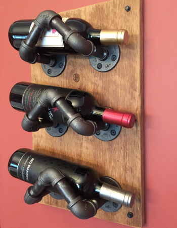 This industrial pipe wine rack is perfect for a kitchen with an industrial feel.