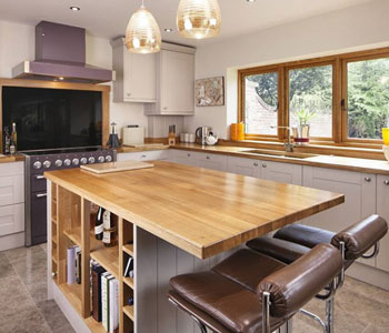 This kitchen features full stave prime oak worktops Elephants Breath Farrow And Ball.