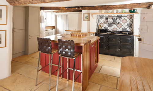 This kitchen island features a rich red colour which complements the rest of the kitchen.