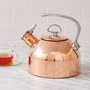Materials with reflective surfaces, such as this copper kettle, will bounce light back into the room.