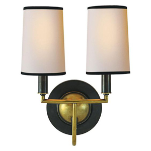 Traditional sconces can be used in a dining area of a kitchen.