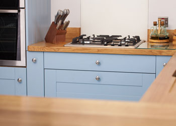 Shaker style drawers painted in Farrow & Ball's Lulworth Blue offer a quintessential Great British Bake Off design.