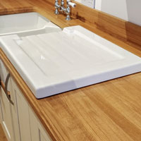 Free up worktop space when your dishes are not drying by using a removable Reginox ceramic Belfast sink drainer.