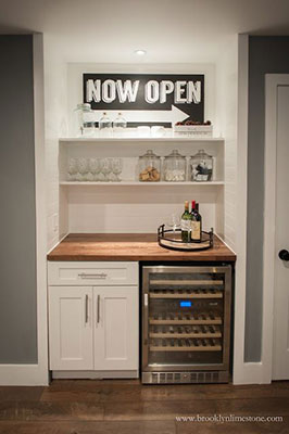 Compact and efficient, this kitchenette doubles up as a personal bar.