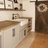 Utility rooms with ceramic sinks have a traditional feel.