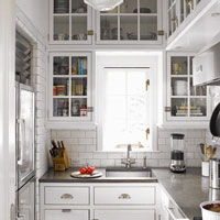 Consider cabinet frontals with glass to increase the light within your kitchen.