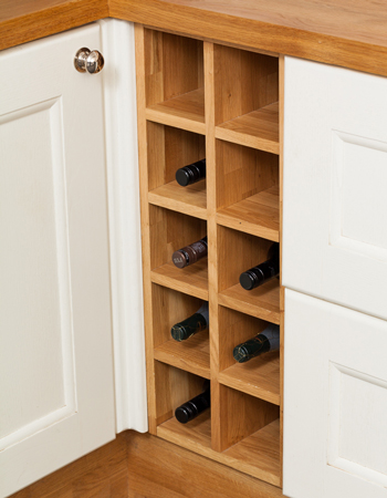 This solid oak wine rack base cabinet integrates seamlessly into your kitchen and holds up to ten bottles of wine.