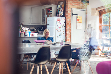 Jo Whiley and a friend in her large kitchen