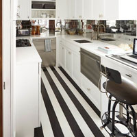 A striped pattern on your kitchen floor will make your space seem longer.