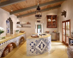 A Mexican kitchen with a large semi-circular tiled island