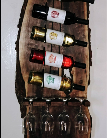 This live edge wine rack has been made by Raws Custom Shop from Ohio walnut slab and black metal wire.