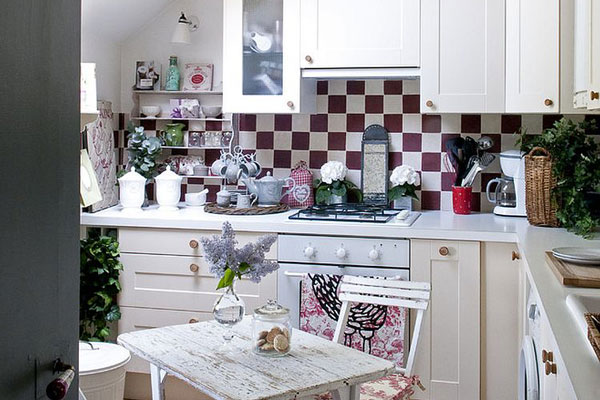 A traditional design has been used in this bijou attic kitchen