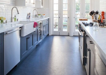 Dark coloured Linoleum has been used in this kitchen to complement the cabinets.