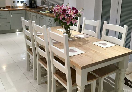 A pale coloured dining table to complement a light and airy kitchen.