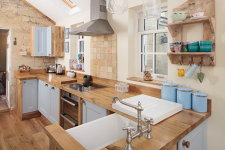 Farrow & Ball's Blue Ground is the colour of choice for this oak kitchen.