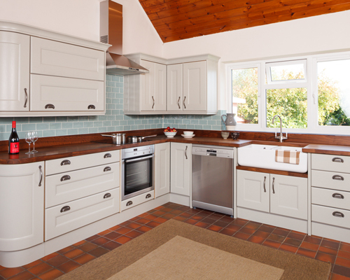 This L-shaped kitchen shows two of the three points of a working triangle.